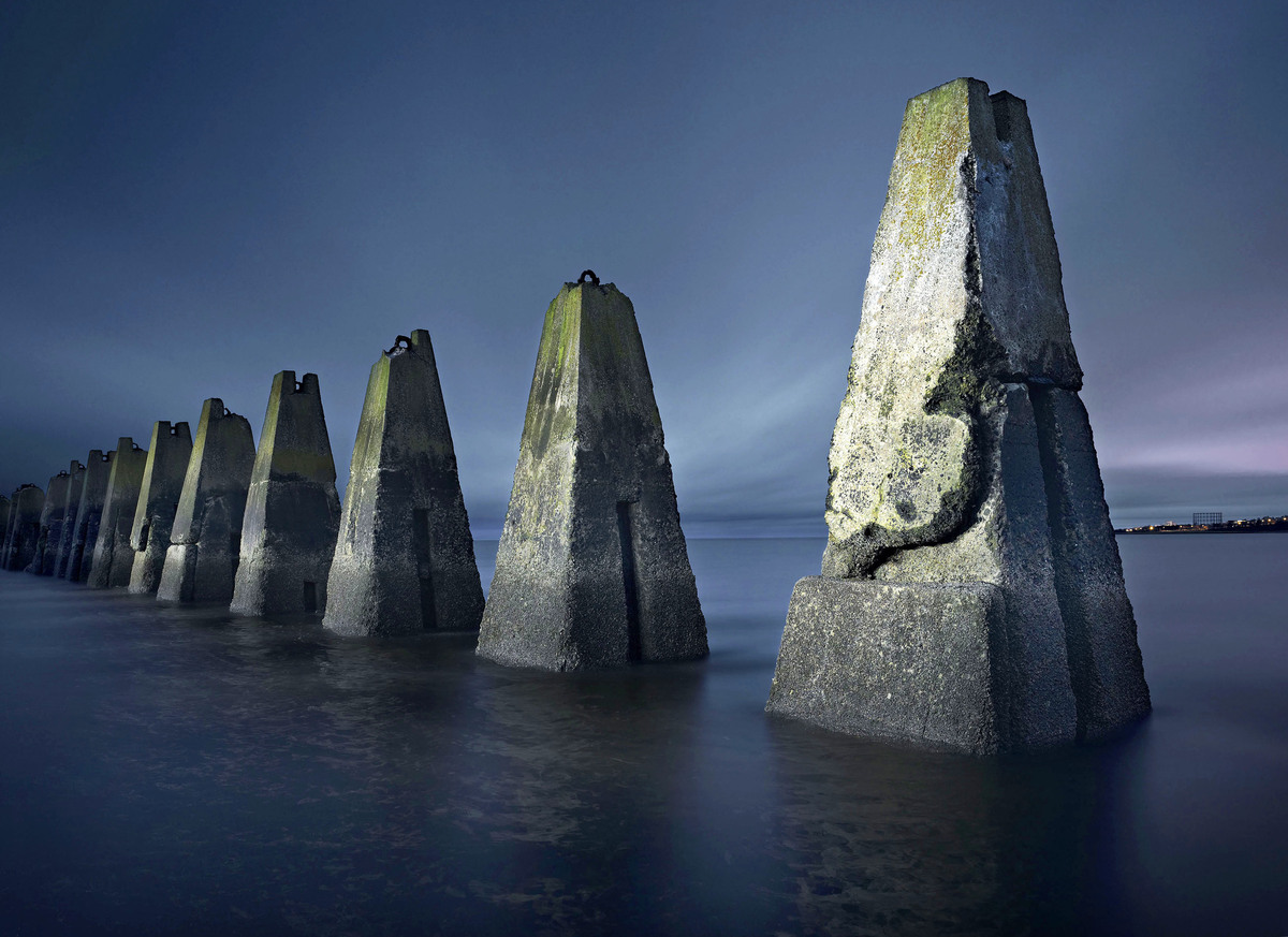 (Pictured the Cramond Island WW2 submarine defense boom) - These are the eerie images of World War II bunkers that still crou