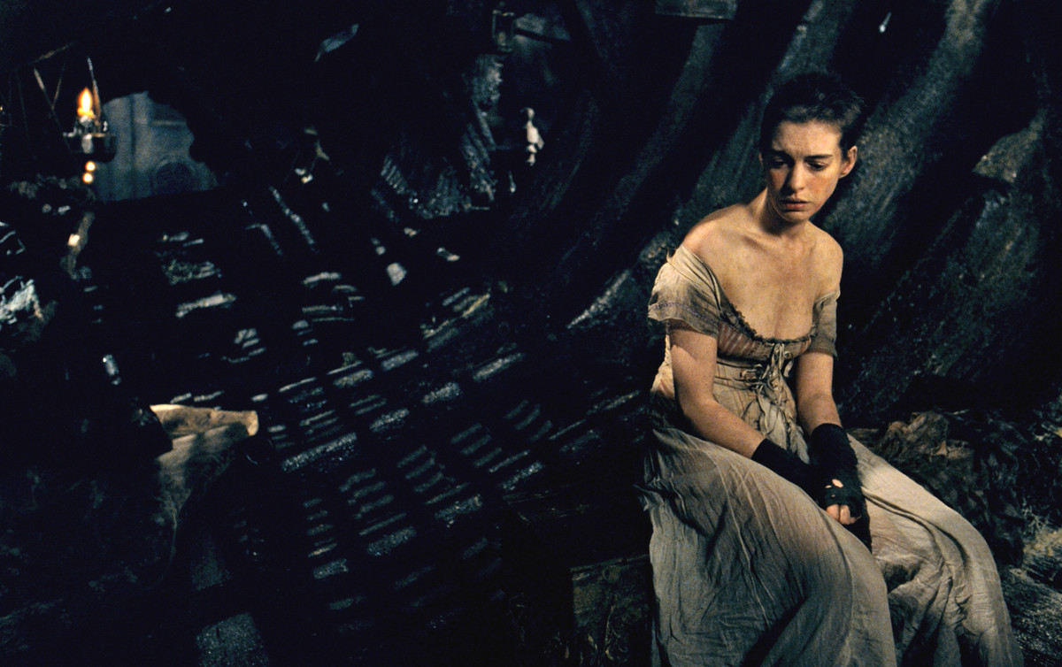 """This image released by Universal Pictures shows Anne Hathaway as Fantine in a scene from """"Les Misérables."""" The costumes for t"""