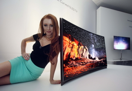 """Warning: Curves ahead!  Samsung and LG <a href=""""http://www.huffingtonpost.com/2013/01/08/curved-televisions-by-samsung-lg_n_2"""