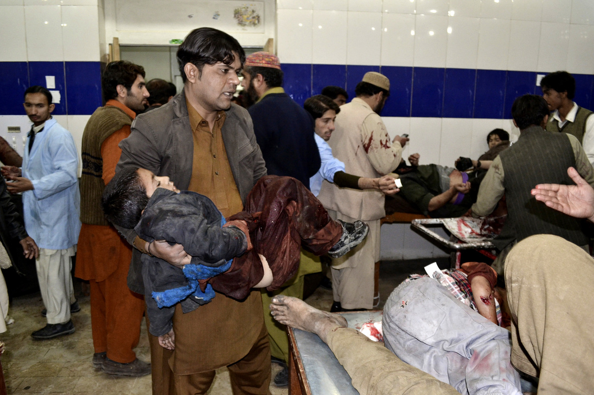 A Pakistani child who was injured in a bomb blast is brought to a hospital for treatment in Quetta, Pakistan, Thursday, Jan.
