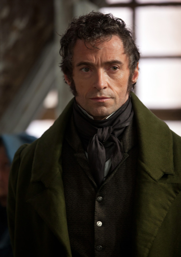 "This image shows Hugh Jackman as Jean Valjean in a scene from ""Les Miserables."" The costumes for the film were designed by Sp"