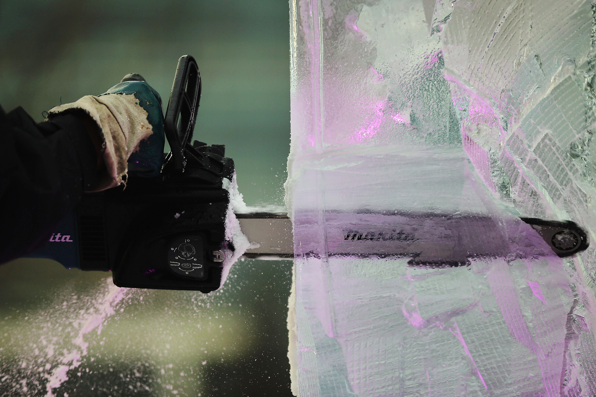 A contestant works on an ice sculpture at The London Ice Sculpting Festival at Canary Wharf on January 11, 2013 in London, En