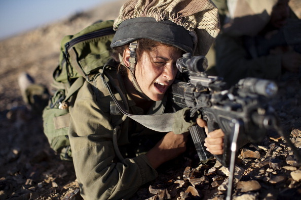 A female soldier from the 'Karakal' Battalion in action during training near the Israeli-Egyptian border on December 14, 2010