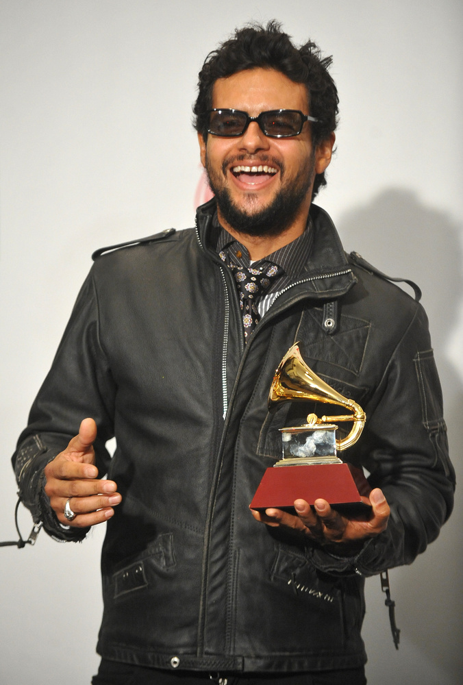 Best Rock Solo Vocal Album category winner Draco Rosa, for his album 'Teatro,' poses with his trophy at the 2009 Latin Grammy