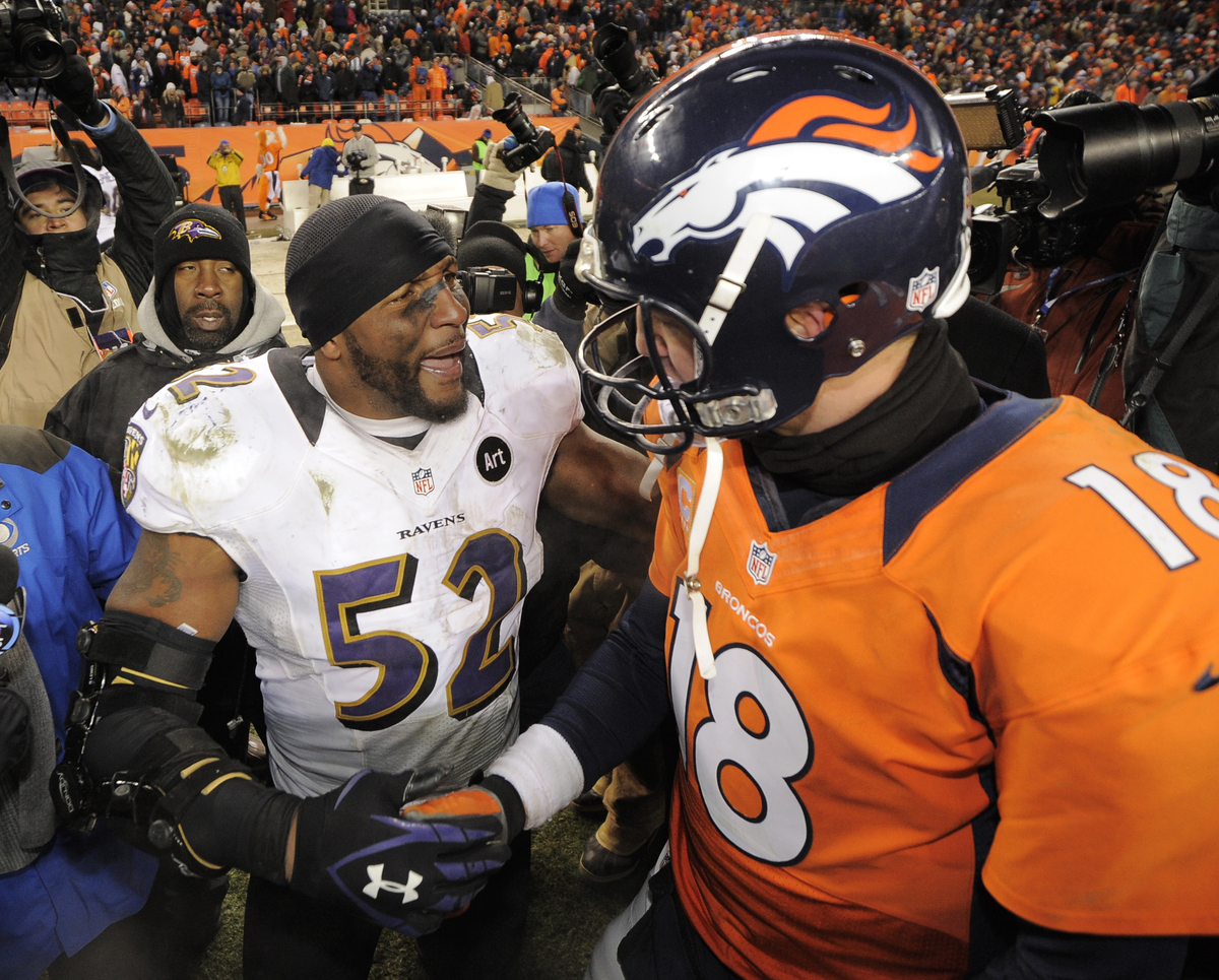 Baltimore Ravens inside linebacker Ray Lewis shakes hands Denver Broncos quarterback Peyton Manning (18) after the Ravens won