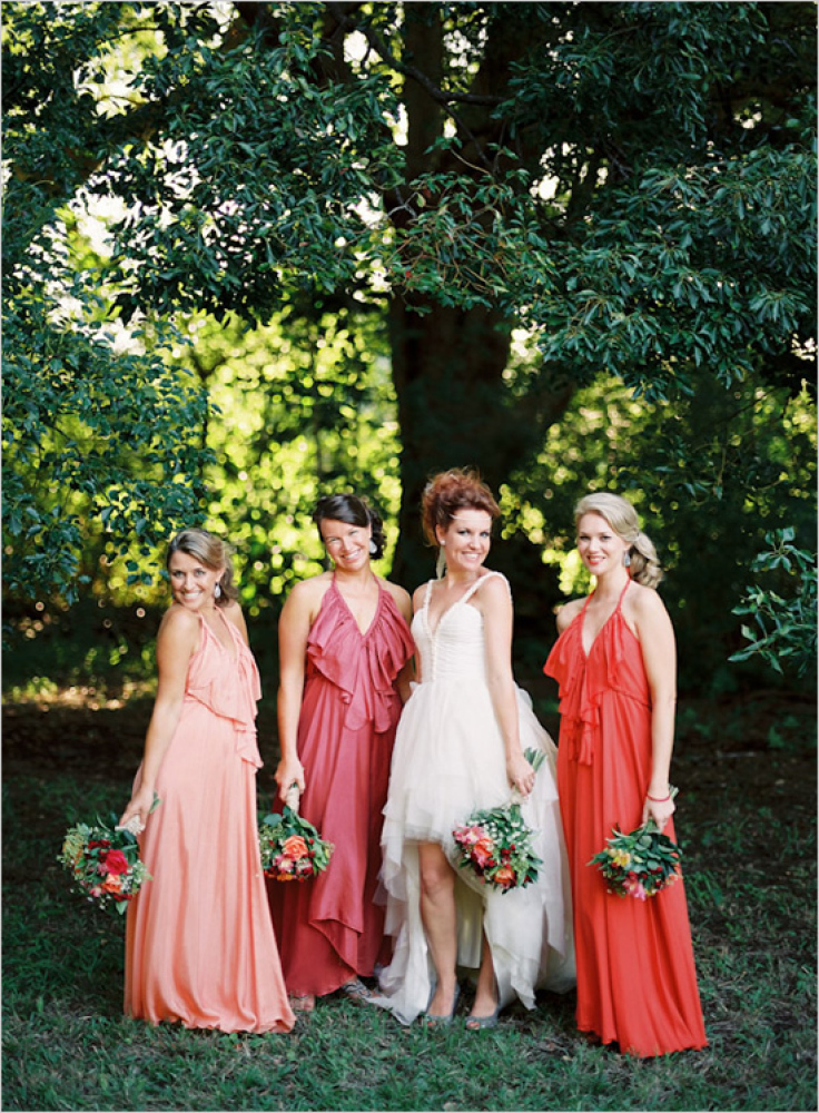 Let's start things off with this flirty ruffled gown. Each bridesmaid is wearing the same dress, but we like how the bride ch