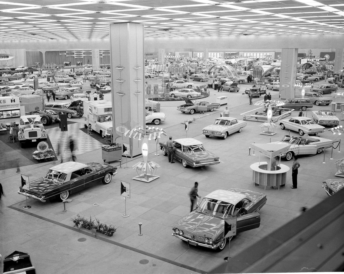 In this Oct. 14, 1960 file photo, people visit the National Auto Show at Cobo Hall in Detroit. Hundreds of thousands of buyer
