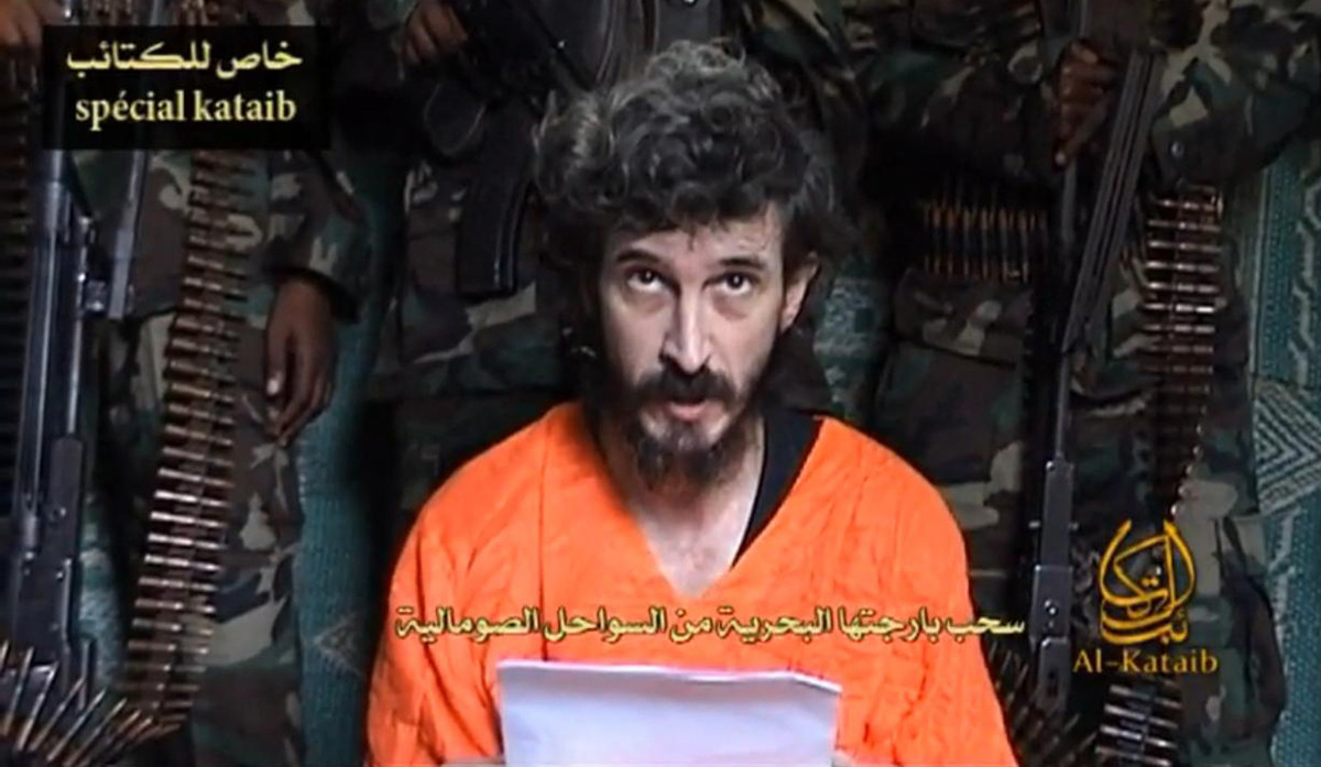 In this undated file image from a video posted on islamic militant websites and made available Wednesday June 9 2010, a man i