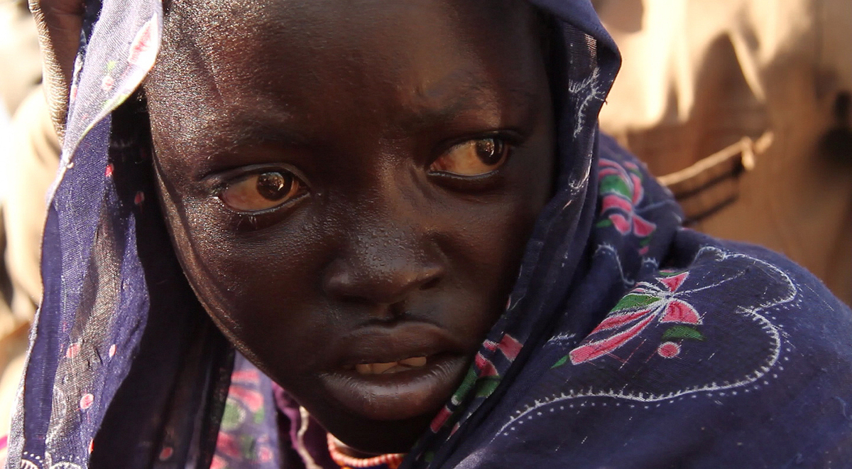A young refugee just crossed into rebel controlled territory after surviving an ambush by Sudanese armed forces.