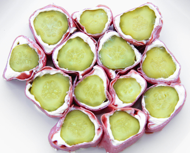 "<strong>Get the <a href=""http://www.pipandebby.com/pip-ebby/2010/11/26/pickle-roll-ups.html"">Pickle Roll Ups recipe</a> from"