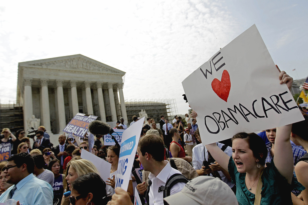 Supporters of President Barack Obama's health care law celebrate outside the Supreme Court in Washington, Thursday, June 28,