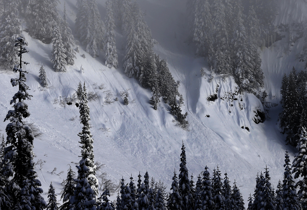In this Jan. 4, 2013 photo, evidence of sliding snow is seen in steep terrain near a ski area at Snoqualmie Pass in Washingto