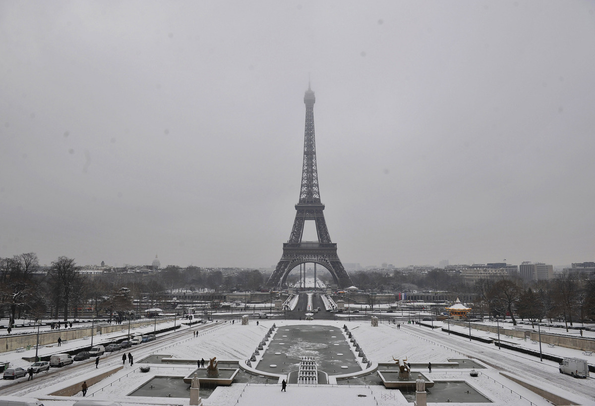 A view of the Eiffel Tower after snowfall, in Paris, Saturday, Jan. 19, 2013. (AP Photo/Zacharie Scheurer)