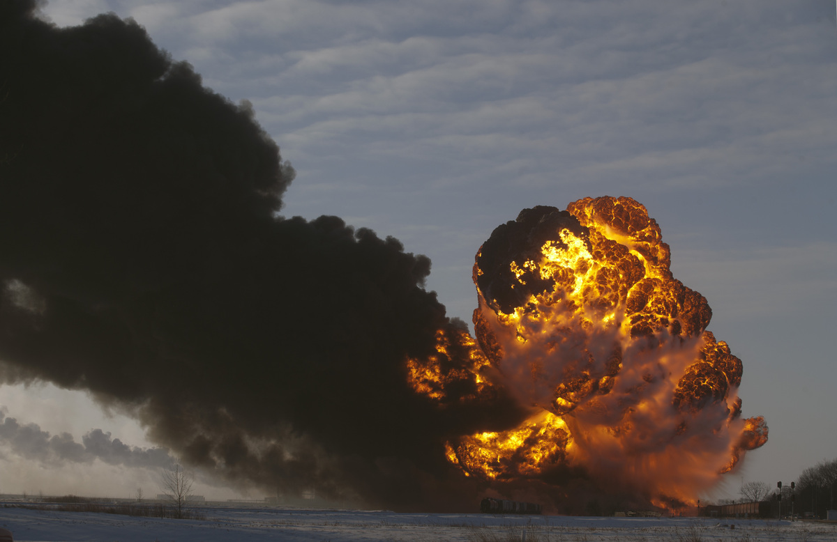 A fireball goes up at the site of an oil train derailment Monday, Dec 30, 2013, in Casselton, N.D. The train carrying crude o