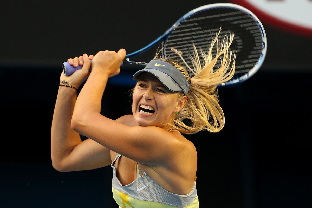 Maria Sharapova of Russia plays a backhand in her third round match against Venus Williams of the United States during day fi