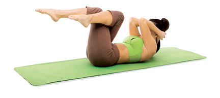 Lie on your back in traditional sit-up position – with your hands clasped behind your head, feet on the floor, and knees bent