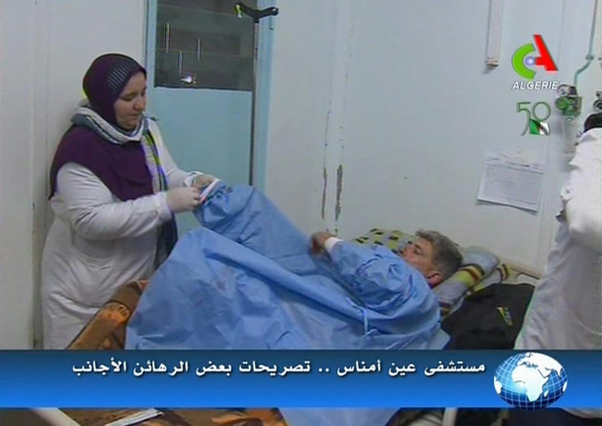 An unidentified rescued hostage receives treatment in a hospital in Ain Amenas, Algeria, in this image taken from television