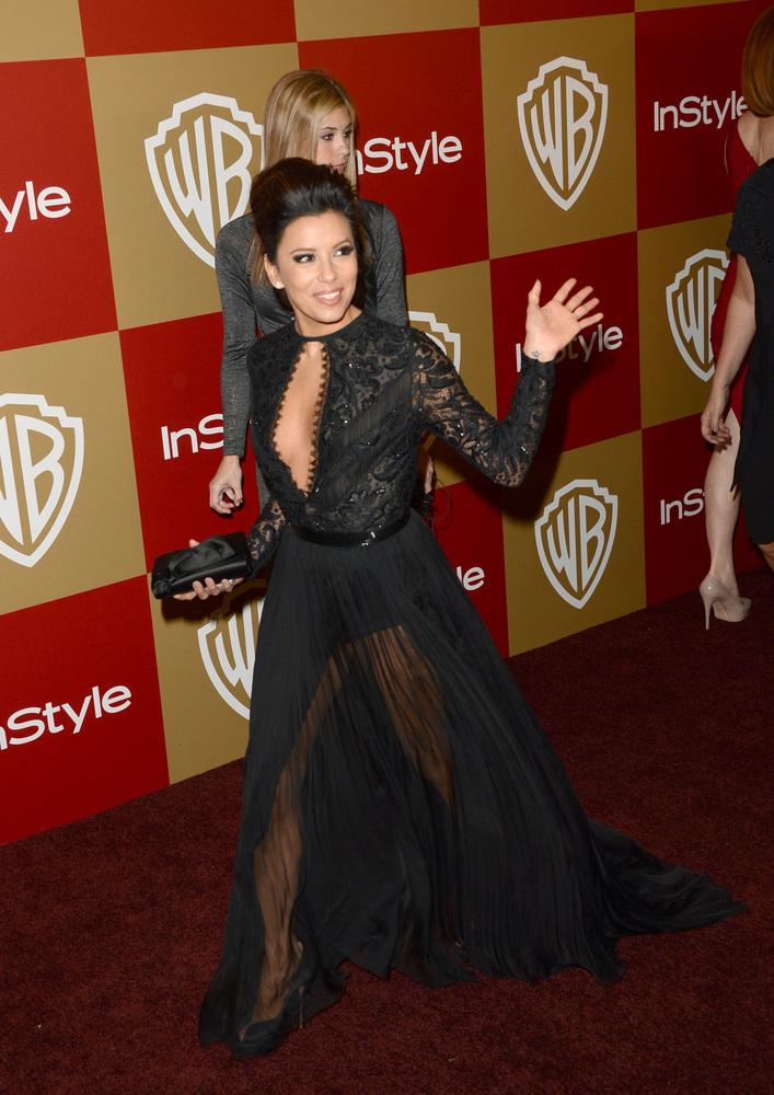 "Eva's Golden Globes getup seemed to be <a href=""http://www.huffingtonpost.com/2013/01/17/eva-longoria-wardrobe-malfunction-go"