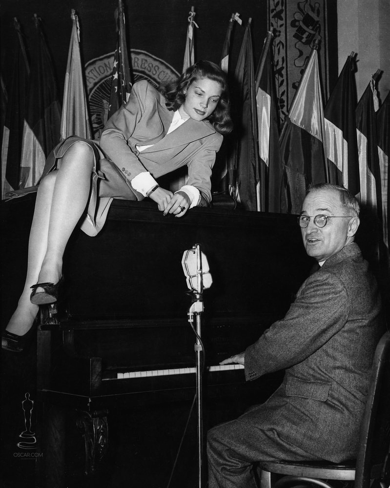 Lauren Bacall and Vice President Harry S. Truman at the National Press Club Canteen in Washington, D.C., on February 10, 1945