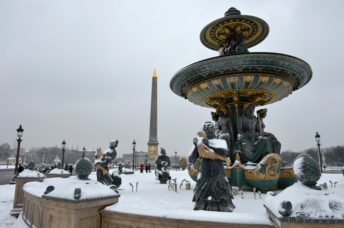 A snow-covered fountain at the Place de la Concorde.  (MIGUEL MEDINA/AFP/Getty Images)
