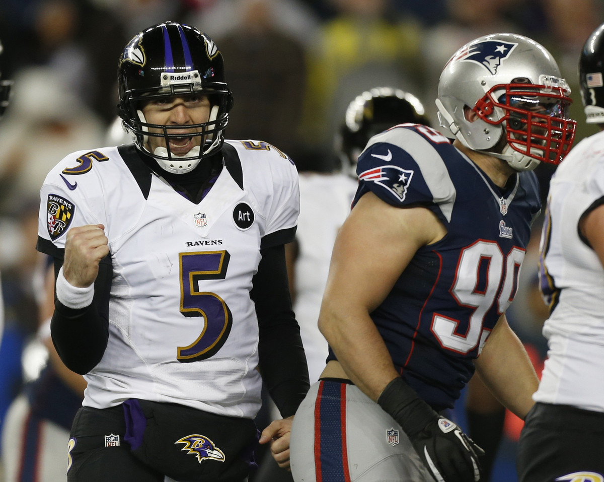 Baltimore Ravens quarterback Joe Flacco (5) reacts after throwing a five-yeard touchdown pass to Dennis Pitta during the seco