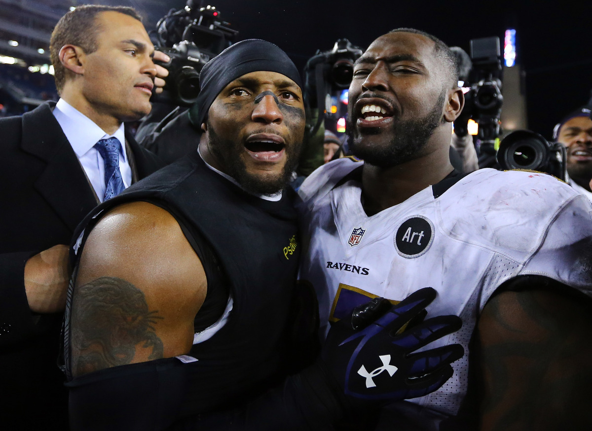 FOXBORO, MA - JANUARY 20:  Ray Lewis #52 of the Baltimore Ravens celebrates with teammate Arthur Jones #97 after defeating th