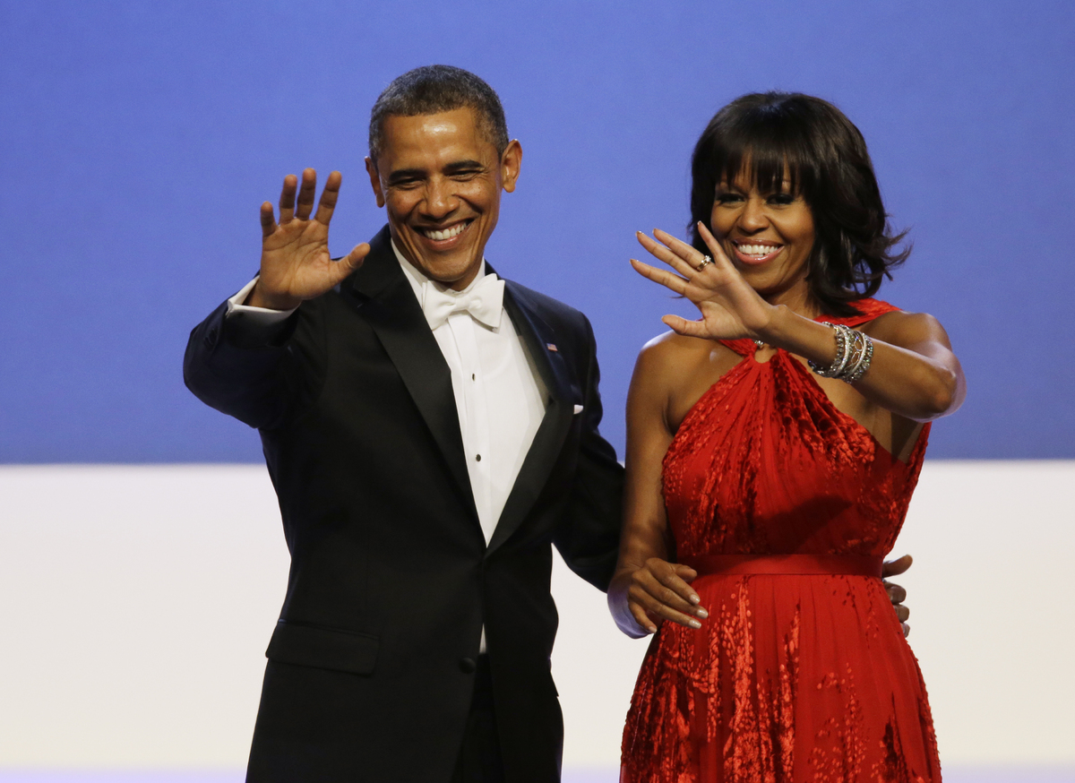 President Barack Obama and Michelle Obama wave to guests after their dance at the Inaugural Ball at the 57th Presidential Ina