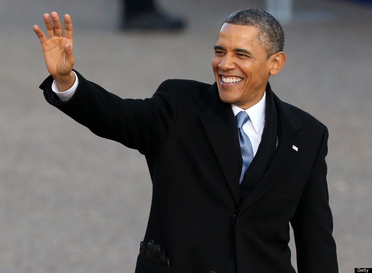 U.S. President Barack Obama waves as the presidential inaugural parade winds through the nation's capital January 21, 2013 in