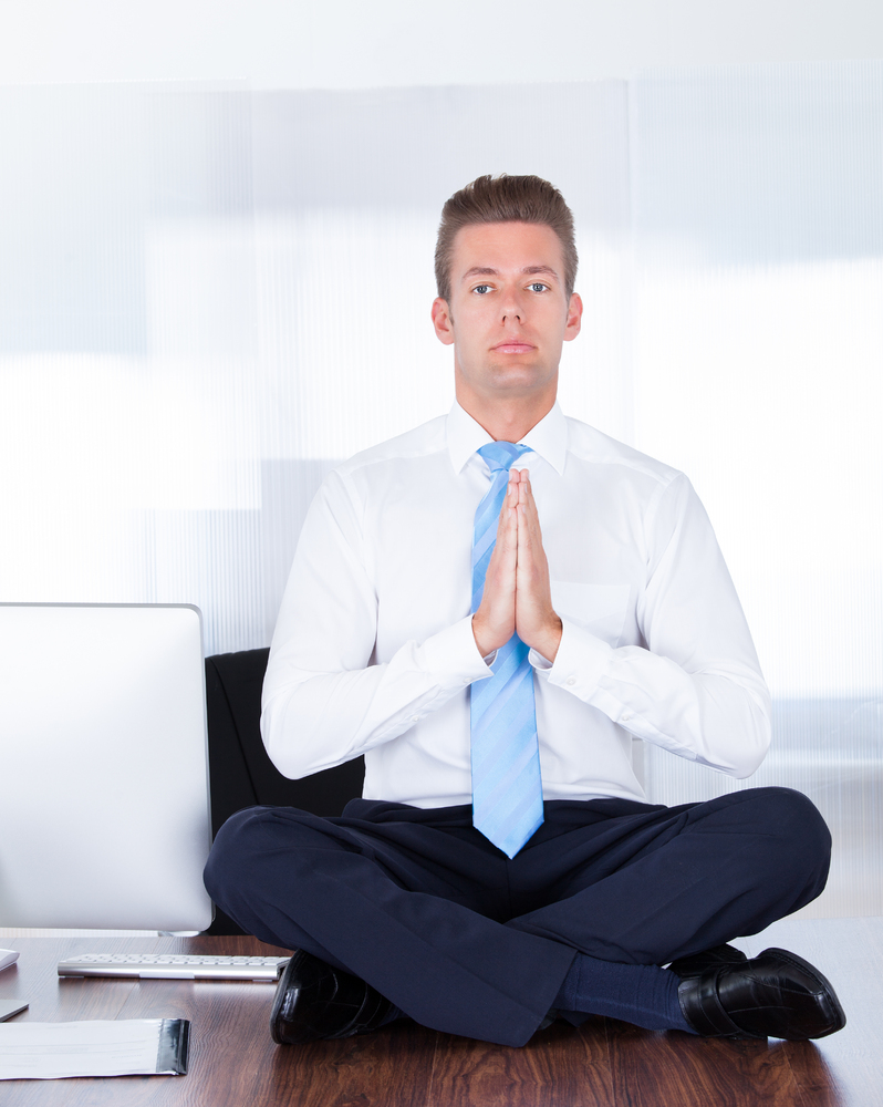 young businessman sitting on...