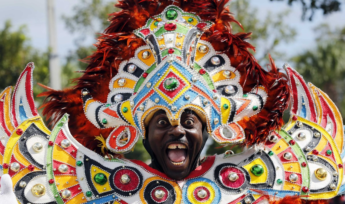 A Miami-Dade carnival dancer performs at the annual Martin Luther King Day parade in Miami, Monday, Jan. 21, 2013, as the nat