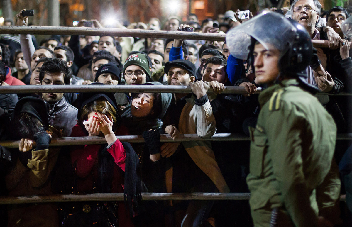 Iranian women react during the execution of Alireza Mafiha and Mohammad Ali Sarvari, unseen, in Tehran, Iran, Sunday, Jan. 20