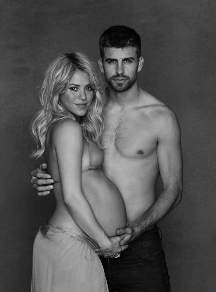 In this photo provided by UNICEF, Colombian born singer Shakira poses, while pregnant, with Spanish soccer player Gerard Piqu