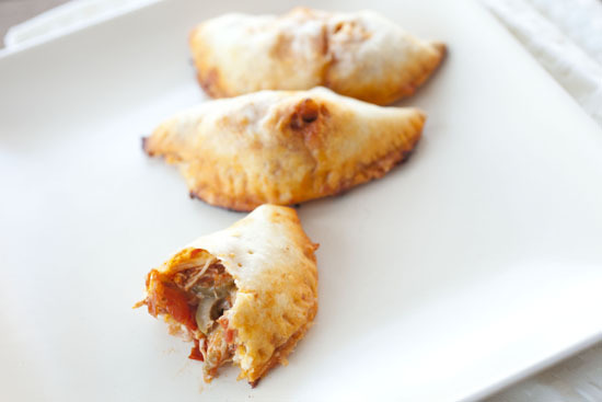 "<strong>Get the <a href=""http://www.macheesmo.com/2013/01/pulled-chicken-empanadas/"">Pulled Chicken Empanadas recipe</a> by M"