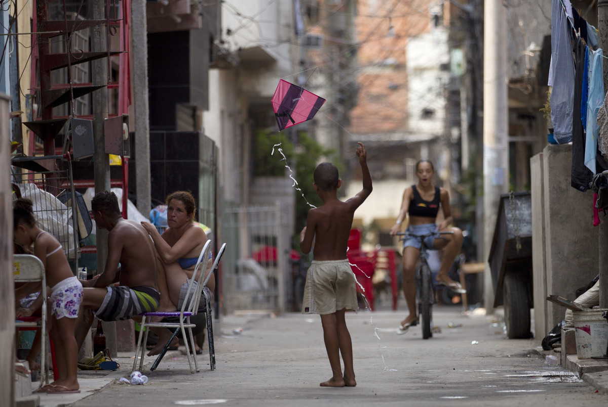 In this Dec. 28, 2012 photo, a child flies a kite in the Mare shantytown in Rio de Janeiro, Brazil. The city's densest neighb