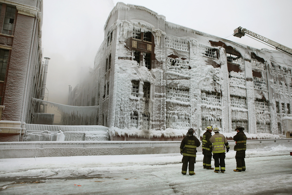 CHICAGO, IL - JANUARY 23: Firefighters work to extinguish a massive blaze at a vacant warehouse on January 23, 2013 in Chicag