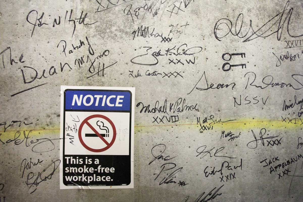 In this Jan. 15, 2013 photo, autographs cover a wall on a top floor of One World Trade Center in New York. Construction worke
