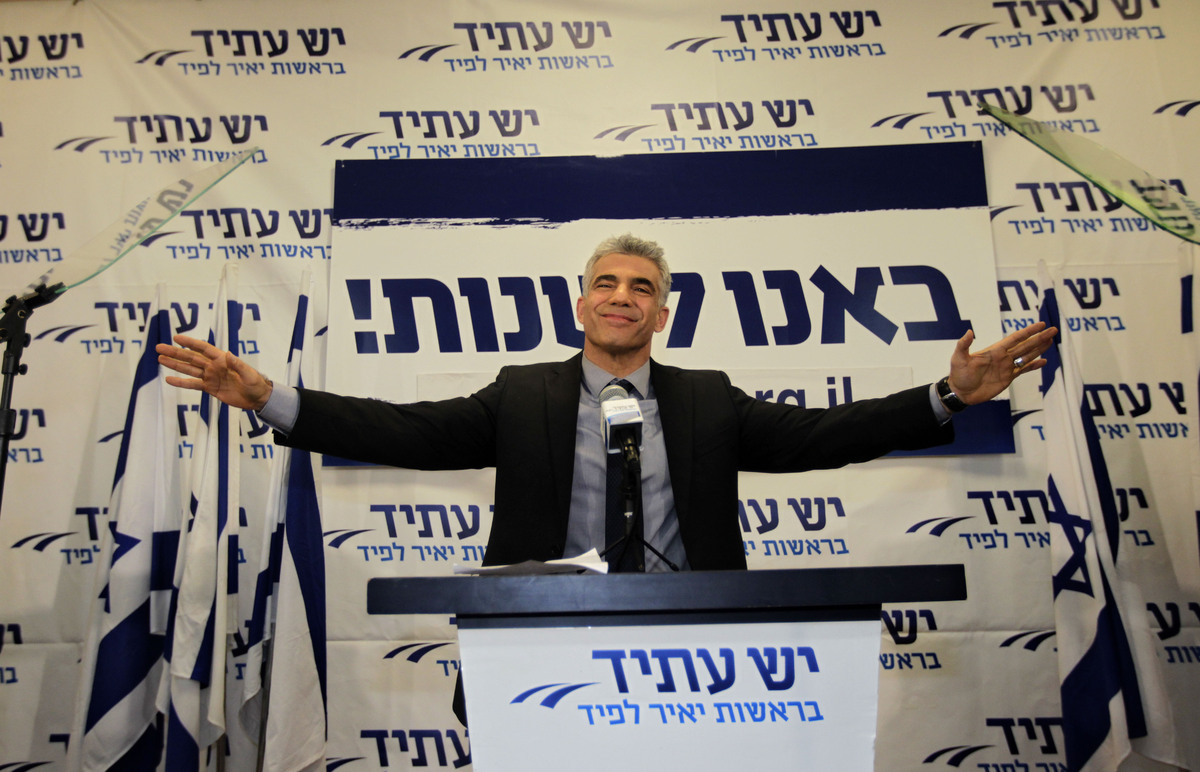 "Yair Lapid gestures as he delivers a speech at his ""Yesh Atid"" party in Tel-Aviv Wednesday, Jan. 23, 2013. (AP Photo/Sebastia"