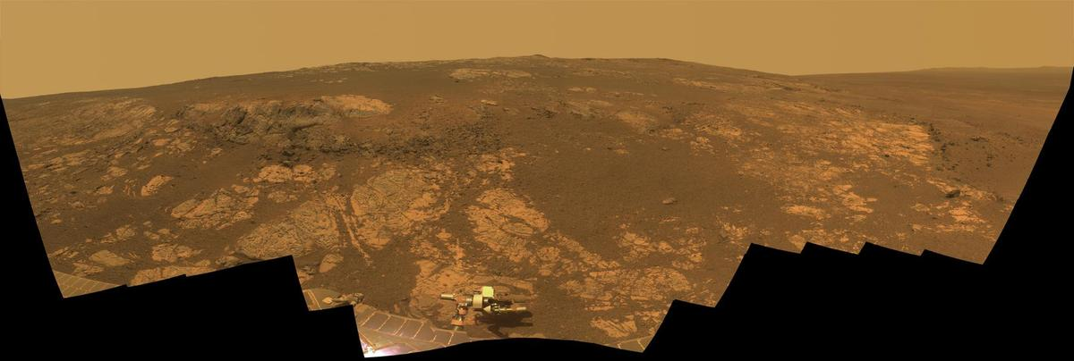 Mars rover Opportunity's panoramic camera recorded the segments of this scene, in November and December of last year. The dig