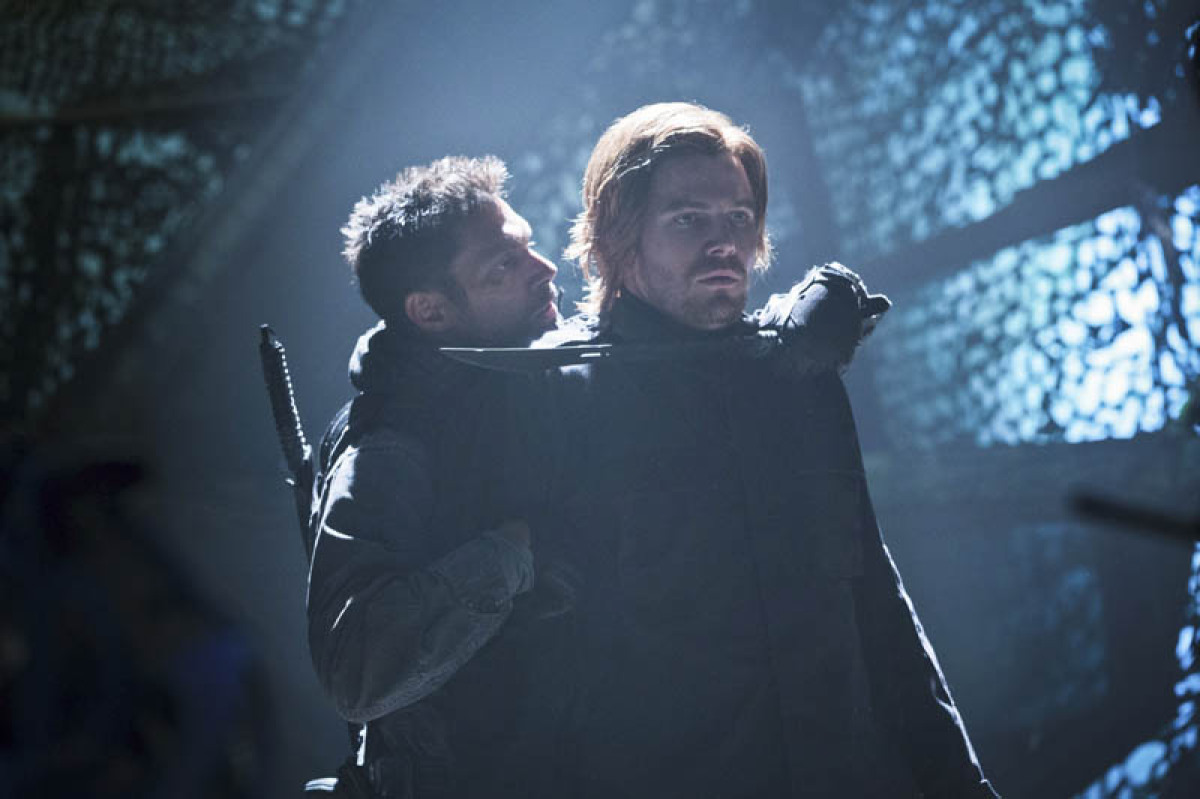 Pictured (L-R): Manu Bennett as Slade Wilson and Stephen Amell as Oliver Queen.