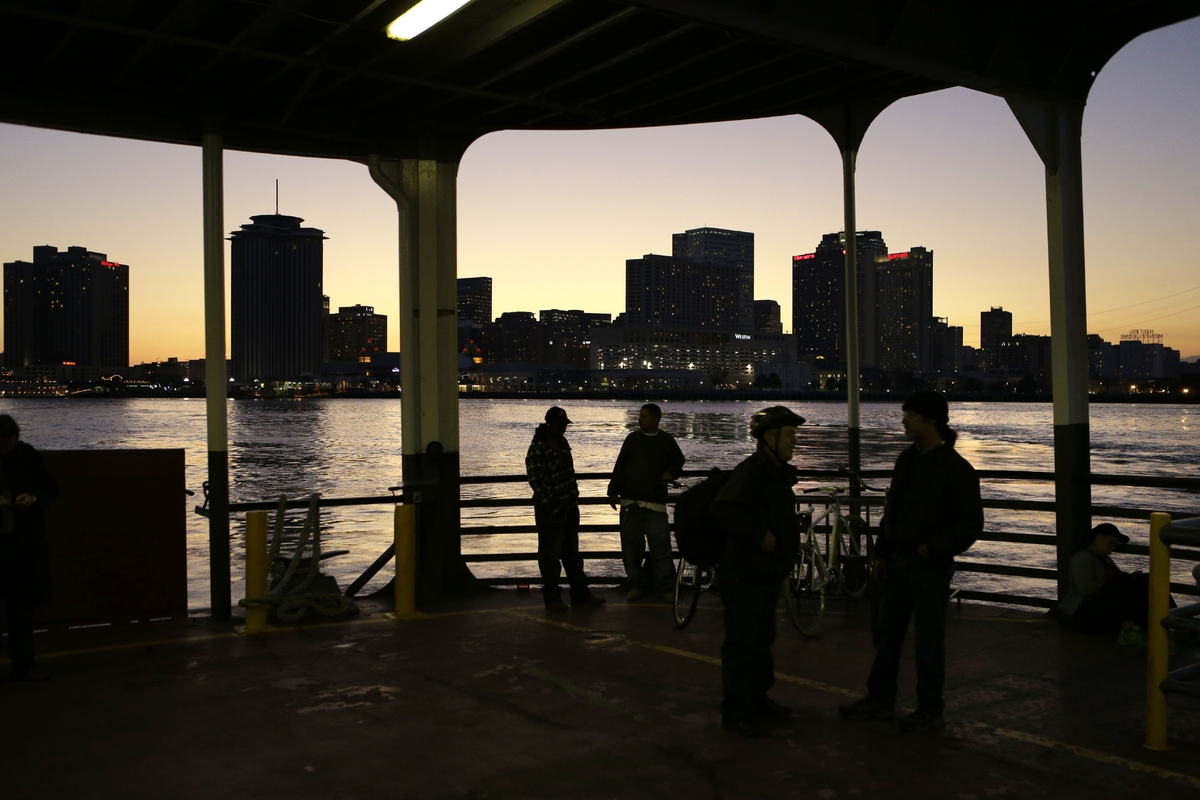 People ride the ferry boat across the Mississippi from downtown New Orleans. The Algiers Point ferry has been in operation si