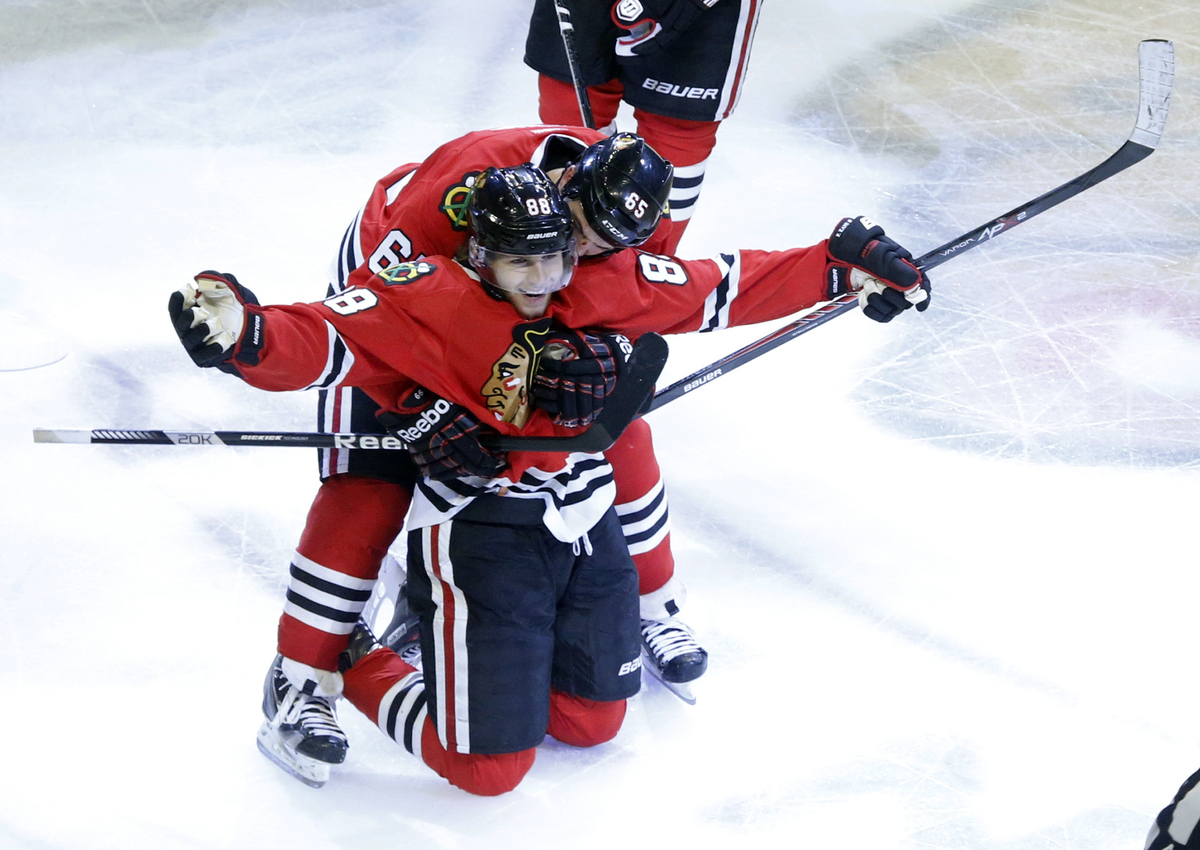 Chicago Blackhawks right wing Patrick Kane (88) celebrates his game winning goal with center Andrew Shaw (65) during the seco