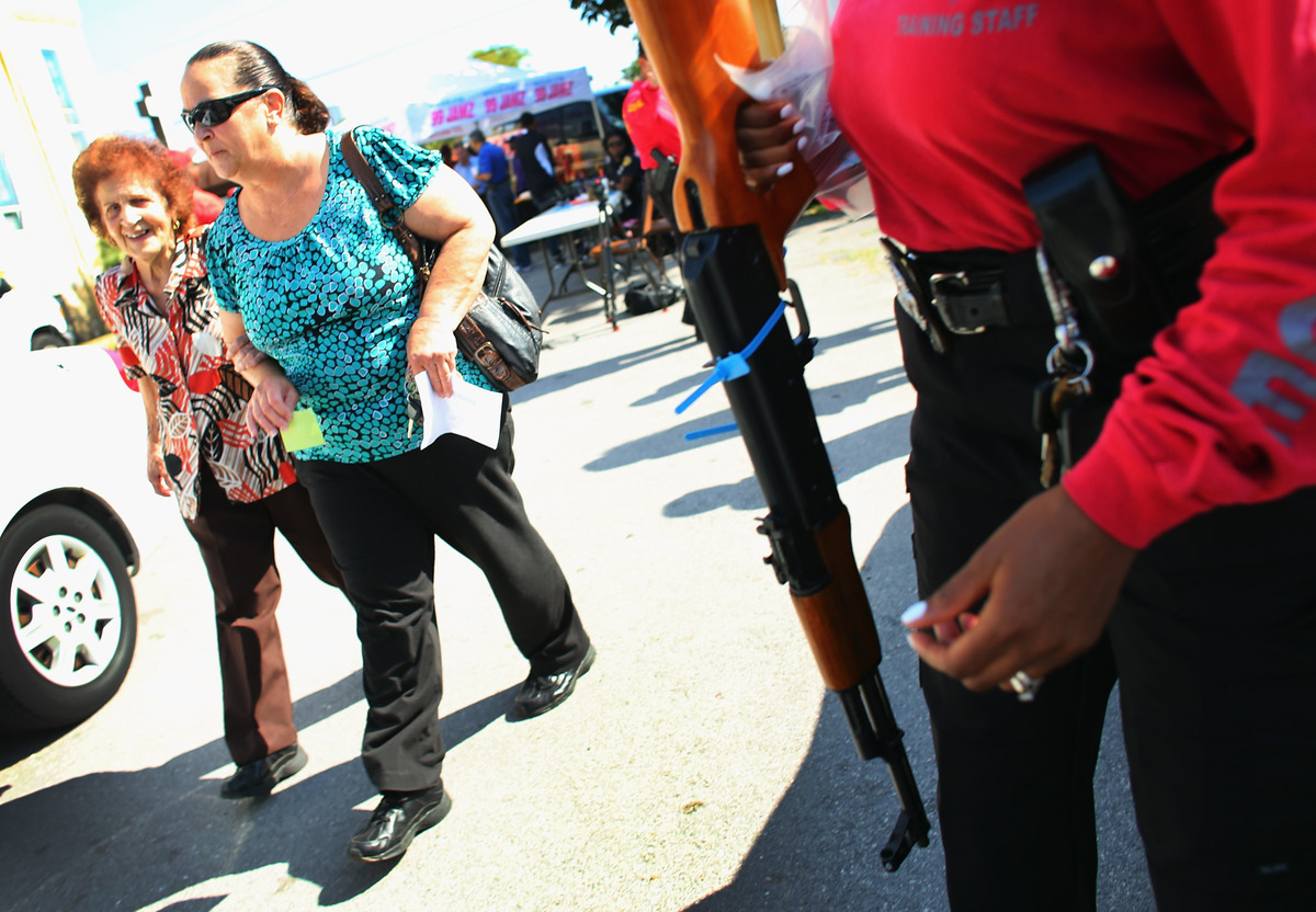 MIAMI, FL - JANUARY 26:  Olga Moran (L) and Azalea Moran walk together after turning in an AK-47  as the City of Miami police