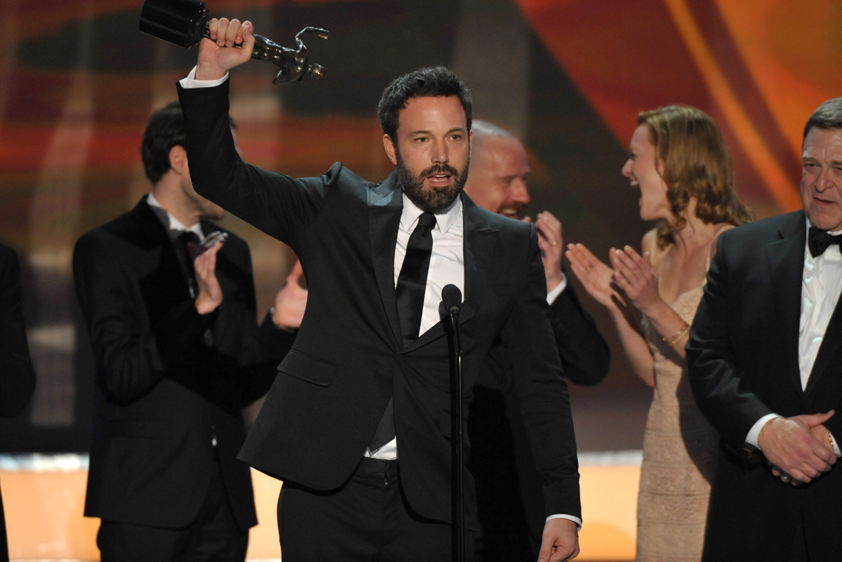 "Ben Affleck, center, and the cast of argo accept the award for outstanding cast in a motion picture for ""Argo"" at the 19th An"