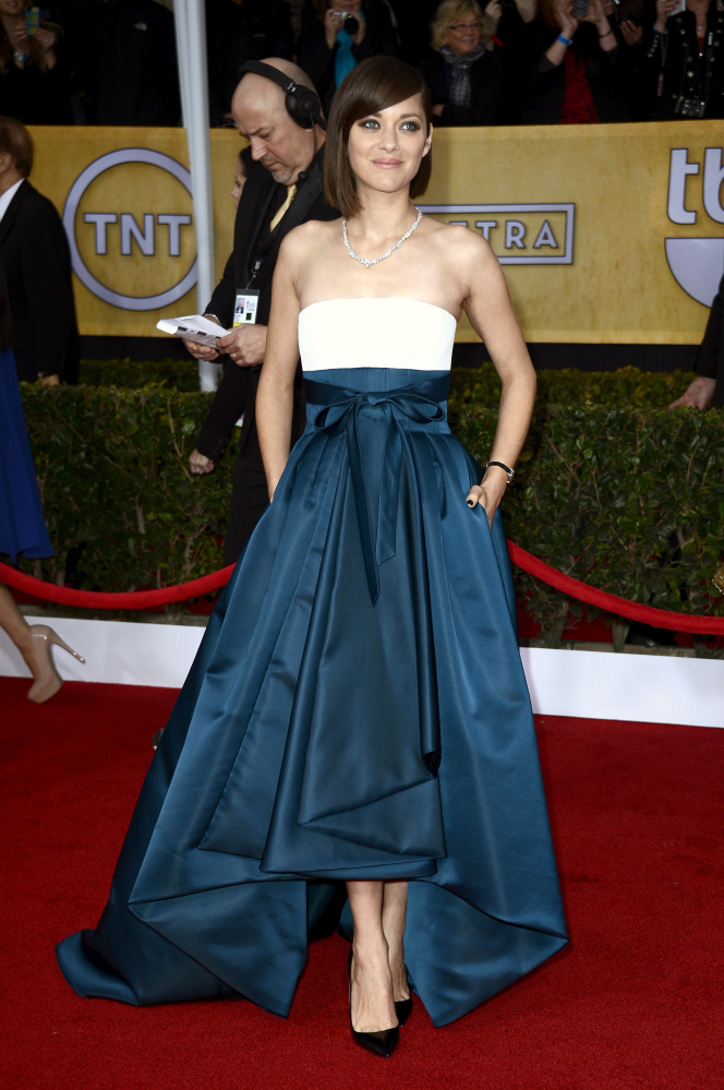 """In a sea of column gowns, the <a href=""""https://www.huffpost.com/entry/marion-cotillard-style-evolution-photos_n_984978"""">Frenc"""