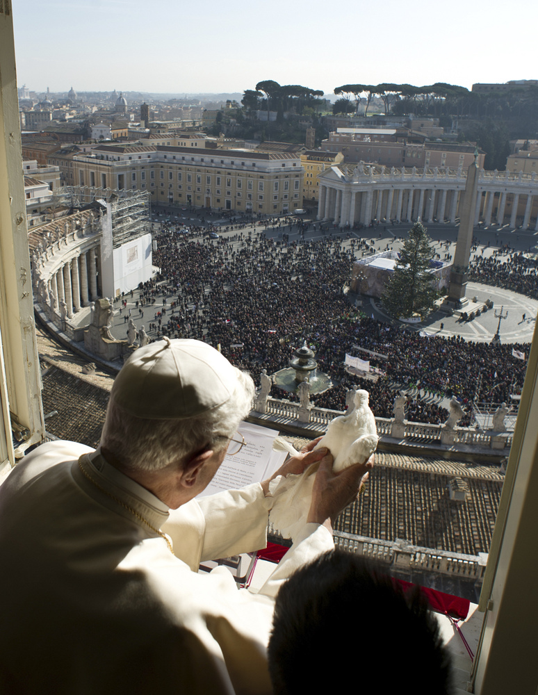 In this photo provided by Vatican paper L'Osservatore Romano, Pope Benedict XVI holds a dove he is about to set free, at the