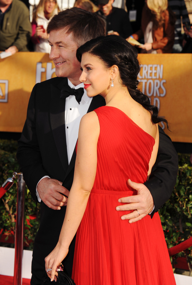 Actor Alec Baldwin and wife Hilaria Thomas walk the red carpet at the Screen Actors Guild Awards.