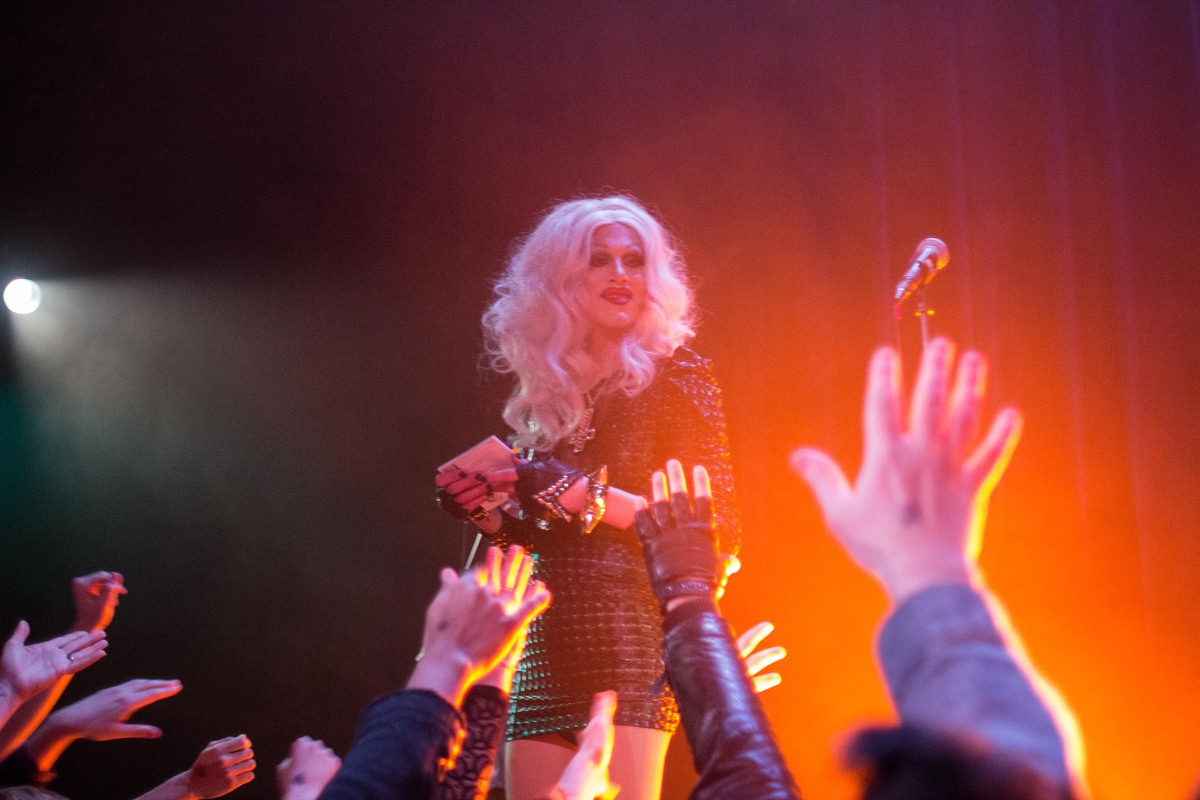 The reigning queen of <em>RuPaul's Drag Race</em>, Sharon Needles, hands out copies of her debut album, <em>PG-13</em>, to an