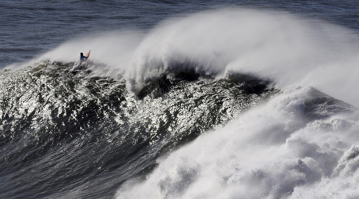 A surfer takes part in the Arnette Punta Galea Big Wave World Tour, on January 28, 2013 in the Northern Spanish Basque town o