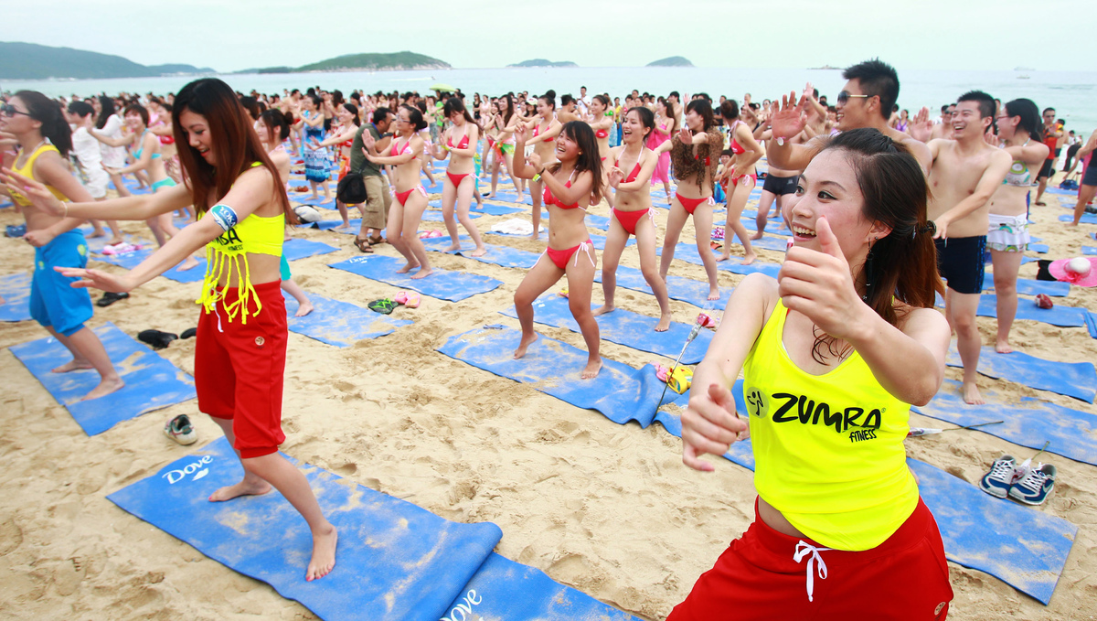 A group of party-goers at a bikini beach party in Sanya. A very organized good time. (Photo credit should read STR/AFP/GettyI