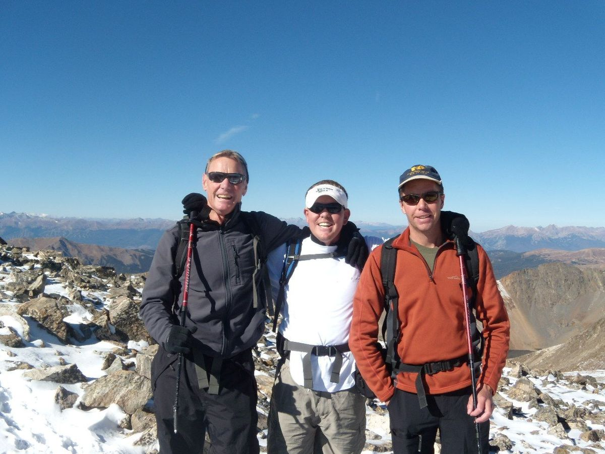 John with his father Tom and friend Eric Alexander as they embark on a climb. Eric Alexander leads Higher Summits, an organiz